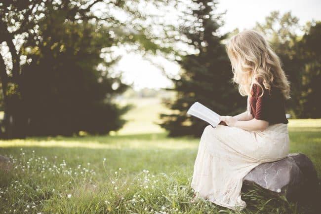 women reading a book best retirement books