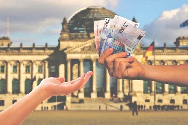 person holding money bills
